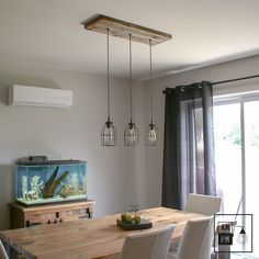 The rustic suspended luminaire has 3 descents on twisted wire in zig-zag . Rustic Pendant Lighting, Rustic Light Fixtures, Industrial Chandelier, Light Pendant, Tuscan Living Rooms, Roof Ceiling, Wooden Ceilings, Mediterranean Home Decor, Roof Light