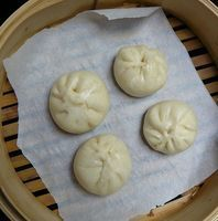 Steamed chicken and shiitake mushroom bun.