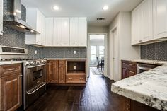 """gray glass tile backsplash, two-toned cabinets - 7th Flip - Finished """"After"""" Photos by It's Great To Be Home"""