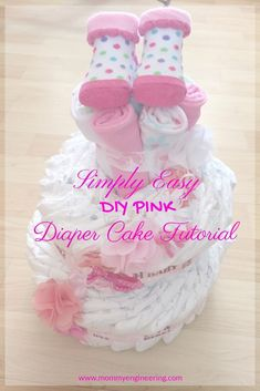 Diaper cakes make wonderful baby shower gifts and they are quite easy to make!  Purchasing one can be expensive so save some money and make your own diaper cake with this simply easy tutorial on this pink diaper cake! Save Money with this Simply Easy DIY Pink Diaper Cake Tutorial #diapercake #DIYbaby #babyshower #DIYBabyshower #babyshowergifts #giftideas #babygifts