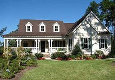 3 beds, 2.5 baths, 2045 sq ft Country charmer with a wrap-around porch.  Kit/den/breakfast with formal dining.
