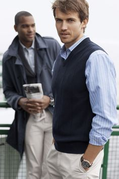 A sweater vest layered over a collared shirt makes for a great business casual look for men! I like vests!