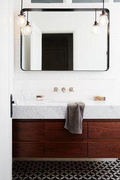 Marble sinks and hex tiles and industrial lighting, OH MY! Delicious bathrooms to love by Studio M...