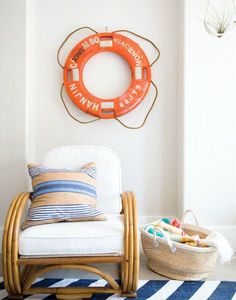 Life preserver wall decor in a Jersey Home with a Surf Vibe: http://www.completely-coastal.com/2015/10/jersey-shore-beach-house-with-California-surf-vibe.html
