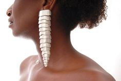 Articulated earrings made by brazilian designer FLAVIA AMADEU-BR.  Materials: ostrich leather, sterling silver.