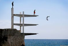 People dive into the Mediterranean Sea on a hot summer's day in Nice, southern France (Sebastien Nogier/EPA)