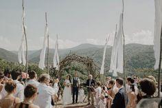 Handmade flags + ceremony arbor