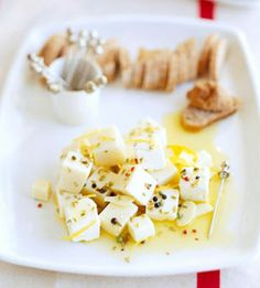 Marinated Cheese Toss together a bit of garlic and lemon juice with peppercorns and Monterey Jack cheese for a simple and easy appetizer recipe. Cheese Appetizers, Finger Food Appetizers, Easy Appetizer Recipes, Finger Foods, Party Recipes, Yummy Appetizers, Dip Recipes, Yummy Recipes, Marinated Cheese
