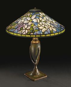 """CLEMATIS"""" TABLE LAMP with an urn-form """"Crutch"""" base  shade impressed TIFFANY STUDIOS NEW YORK 1480-10 base impressed 444/TIFFANY STUDIOS/NEW YORK   leaded glass and patinated bronze  22  1/4  in. (56.5 cm) high 18  5/8  in. (47.3 cm) diameter of shade  circa 1905"""