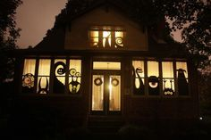 Monster House! Love the silhouettes of Halloween monsters in the  window !