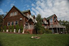This beautiful vacation rental home has an incredible panoramic view of Deep Creek Lake and surrounding mountains. It has 9 bedrooms, 8.5 baths and sleeps 26. Behind-the-scenes shot from Getting Away Together, a new travel show for PBS member stations