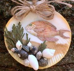 Striped fish sea shell ornament_beach by CarmelasCoastalCraft ... gee, each one of hers is just as pretty. Bigger eyes and this would be sorta squirrel-fishesque.