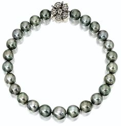 Natural gray color cultured pearl necklace with diamond flower clasp. Via Sotheby's.