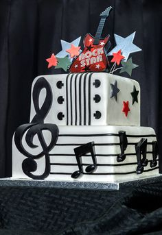 The Ultimate Celebrity Wedding Cakes besides 197876977351607889 in addition Starry Night Wedding Ideas likewise Cake microphone furthermore Anime Themed Cakes. on rock stars wedding cake topper
