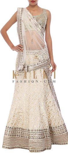 Buy Online from the link below. We ship worldwide (Free Shipping over US$100) http://www.kalkifashion.com/off-white-lehenga-embellished-in-applique-work-only-on-kalki.html