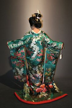 Incredibly detailed wedding kimono. Along with blooming flowers, it looks like it may feature cranes-- birds which often mate for life. Photo by Robert Stein III (rs3art on Flickr)