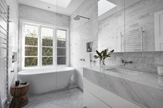 Marble bathroom with a skylight and window in a renovated California bungalow, Northcote, Melbourne, Australia : RoomPorn House Interior, Box Houses, Modern Bathroom, House, Free Standing Bath Tub, Amazing Bathrooms, Bathroom Design, Bungalow Design, Nautical Bathrooms