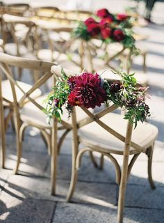 Burgundy Dahlia Chair Decorations: Use this lovely idea for chair decor for the bride and groom's seats at the wedding reception or for your honored family members during the ceremony. It's an elegant and classic way to elevate humble wooden wedding chairs.