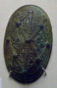 9th C. Norway. Copper alloy oval brooch, pair to no 2: single shell construction; cast lattice-work frame decoration, bossed at intersections, containing S...
