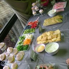 Baby shower food:  veggie pizza bar , fruit pizza bar, chicken salad croissants, chocolate covered strawberries, cupcakes