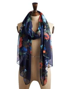 Joules Womens Scarf, Navy Floral.                     With a scarf this colourful, you can now ensure the greyest of days stay a little bright and the nippiest of nights remain a touch warm.