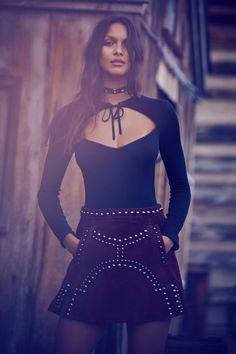 Lais Ribeiro poses in For Love & Lemons Josephina bodysuit and Jameson leather mini skirt for fall 2016 lookbook