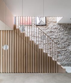 A plywood staircase with vertical slats leads to the first floor in a house in Calais Street, Camberwell, south east London designed by architect David Money. Staircase Storage, House Staircase, Loft Stairs, Staircase Railings, Modern Staircase, Under Stairs, Staircase Design, Stairways, Contemporary Stairs