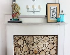 fallen trees used to DIY a faux stacked log look for a {faux} fireplace the HUNTED INTERIOR: Stacked Log Tutorial Unused Fireplace, Fireplace Logs, Fireplace Cover, White Fireplace, Fireplace Inserts, Fireplaces, Fireplace Ideas, Fireplace Filler, Fireplace Facade