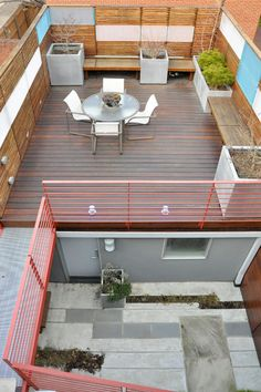 The new roof deck sits above the garage. The couple used premium and durable materials on this renovation, such as ipe wood decking and … - All For Garden
