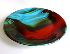 Such gorgeous colors! By artist Beth Reiman and available in her Etsy shop!   Turquoise and Red Streaky Fused Glass  Deep Platter by bprdesigns,