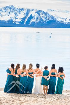 Lake Tahoe winter wedding photography at Edgewood, teal colored bridesmaids dresses   © www.tahoeweddingphotojournalism.com