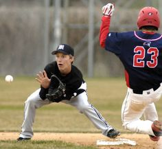 Mandan shortstop Jared Walters makes the play on Century's Cyril Nagurski for a force out.