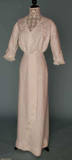 "SUMMER WALKING SUIT, 1908    White linen dress & jacket, both w/ floral embroidery, dress w/ inset lace yoke, B 36"", W 24.5"", DL 60"", JL 29"" (View 2 of 2)"
