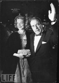 Humphrey Bogart and his glamorous wife Lauren Bacall face fans and flashbulbs in 1955, the year he was nominated for Best Actor for his performance in The Caine Mutiny. He lost to On the Waterfront's Marlon Brando.