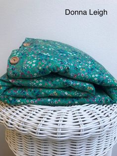 Luxurious reversable duvet cover is handmade with glorious Liberty of London print tana lawn on one side & cotton linen on the reverse side. With a tack style opening closed with our signature wooden buttons and an elegant border for added charm Luxury Duvet Covers, Bed Duvet Covers, Duvet Bedding, Nursery Bedding, Liberty Print, Baby Boots, Cute Hats, Liberty Of London, High End Fashion