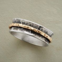 ONLY ONE RING--A hand-hammered sterling silver spool plays host to one slender 12kt gold-filled spinner band. Exclusive. Whole sizes 5 to 9..polishingCloth {display:none