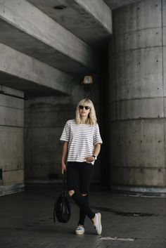 white and black striped tee and ripped black jeans