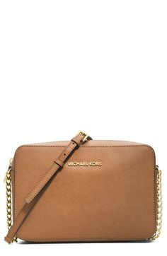 Free shipping and returns on MICHAEL Michael Kors 'Jet Set - Travel' Crossbody Bag at Nordstrom.com. A slender chain-detailed strap suspends the trim silhouette of a sized-down crossbody shaped from scratch-resistant Saffiano leather. The perfect size for traveling light.