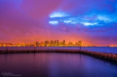 Alex Baltov Photography at Harbor Island, Point Loma, San Diego, California  --     Ominous storm clouds over the San Diego Skyline at dawn this morning - March is coming in like a lion this year. 3/1/2014