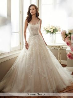 6716497741 Sleeveless misty tulle and sequin full A-line gown features an illusion  bateau neckline trimmed with hand-beading