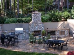 "Outdoor Kitchen with stone fireplace and seating area from ""Outdoor Entertaining"""