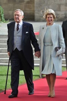 Oct 20 - King Constantine and Queen Anne Marie of Greece emerge from the Cathedral following the wedding ceremony in Luxembourg