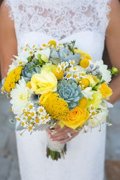 Yellow succulent bridal bouquet. Succulents, chamomile, billy balls, dusty miller, dahlias, ranunculus, yarrow, roses. Florals by Jenny