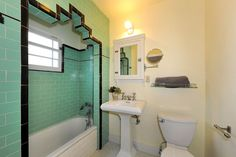 Features include arched doorways, built-ins, painted tile, a dumbwaiter, and a rooftop deck.