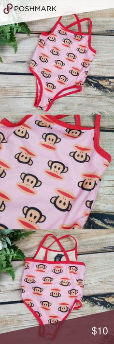 Small Paul By Paul Frank Pink Monkey Swimsuit Small Paul by Paul Frank   Pink one piece bathing suit with monkey Faces. Red trim. Crisscross back. Front lined. 85 Poly , 15 Spandex. Excellent condition. Sz 24 Months  SMOKE FREE HOME Small Paul by Paul Frank Swim One Piece