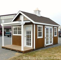 This screams SHE SHED! ~ Garden Shed with Doors, Additional Windows, Cupola, Mushroom Stain, and Custom Porch Backyard Sheds, Outdoor Sheds, Outdoor Rooms, Garden Sheds, Studio Hangar, Shed With Porch, Craft Shed, Custom Sheds, Studio Shed