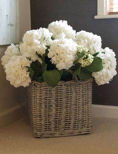 white hydrangea in basket
