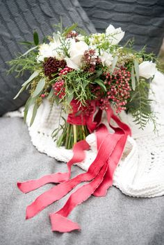 Winter bouquet with red pepper berry and red velvet ribbon  Flowers by Janie- Calgary Wedding Florist www.flowersbyjanie.com  Photo: @tarawhitphoto Velvet Ribbon, Red Velvet, Nosegay, Winter Bouquet, Winter Wedding Flowers, Christmas Wreaths, Berries, Beautiful Bouquets, Table Decorations