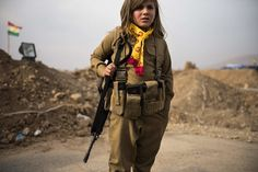 A%20Kurdish%20girl%20wore%20a%20relative%E2%80%99s%20assault%20rifle%20and%20ammunition%20belt%20on%20Thursday%20at%20a%20checkpoint%20east%20of%20Mosul,%20Iraq.