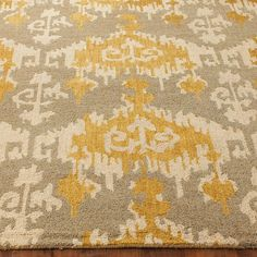 Hand Hooked Gray and Gold Ikat Rug Trending designer hues of Putty Gray with rich Gold and Cream combine in this popular ikat pattern.